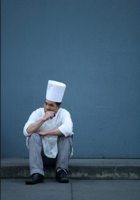 lonely chef thinking about Mental health for yacht chefs